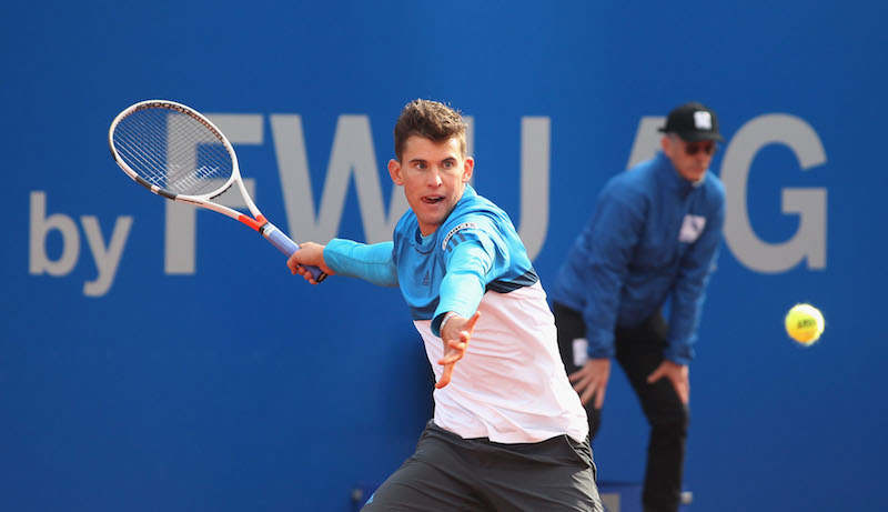 """MUNICH, GERMANY - APRIL 27: Austria's Dominic Thiem plays the ball during the BMW Open at Iphitos tennis club on April 27, 2016 in Munich, Germany. (Photo by Alexandra Beier/Getty Images for BMW)"""